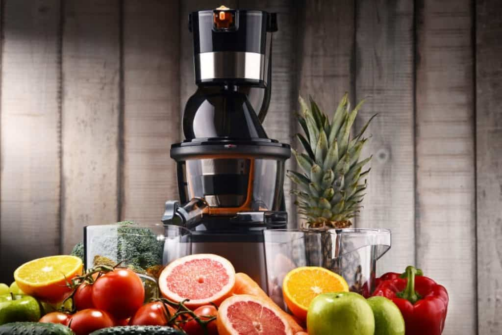 cold press juicer with fruits